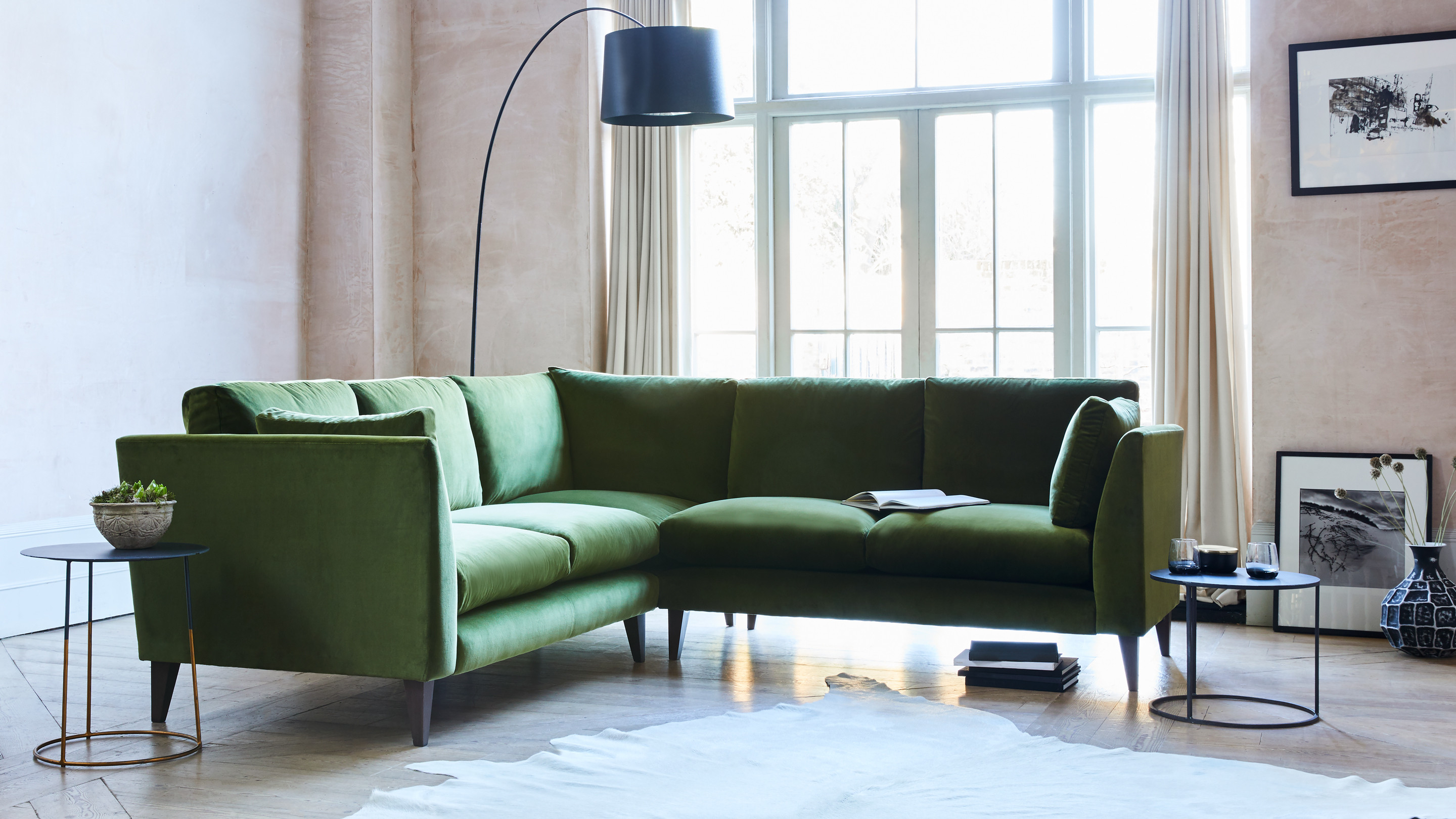 With long, lean lines, Philo is a stunning, mid-century, sink-all-the-way-in corner sofa with enough room for the whole family.
