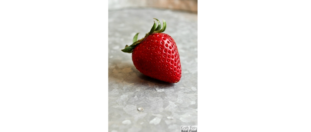 Strawberry on a metal table